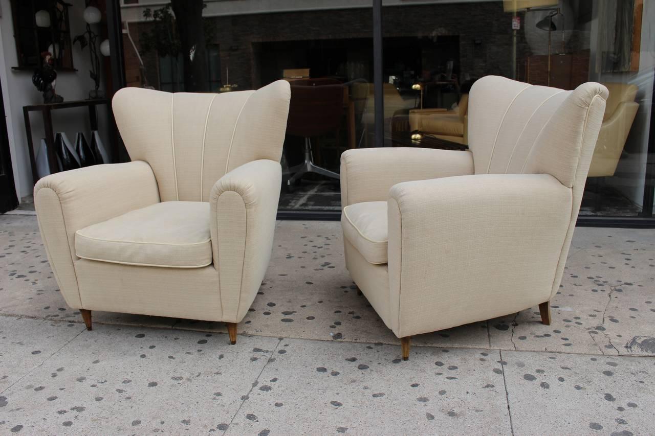 1950s Italian chairs, goose down seat cushions.