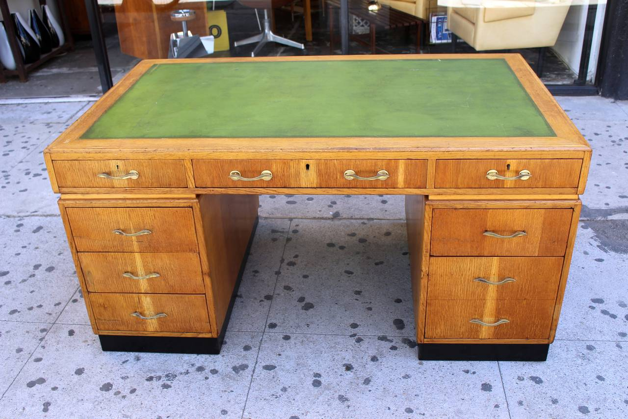 Art Deco desk with the green leather top. Oak base and veneer, brass hardware. Desk can be dismantle for easy transport.