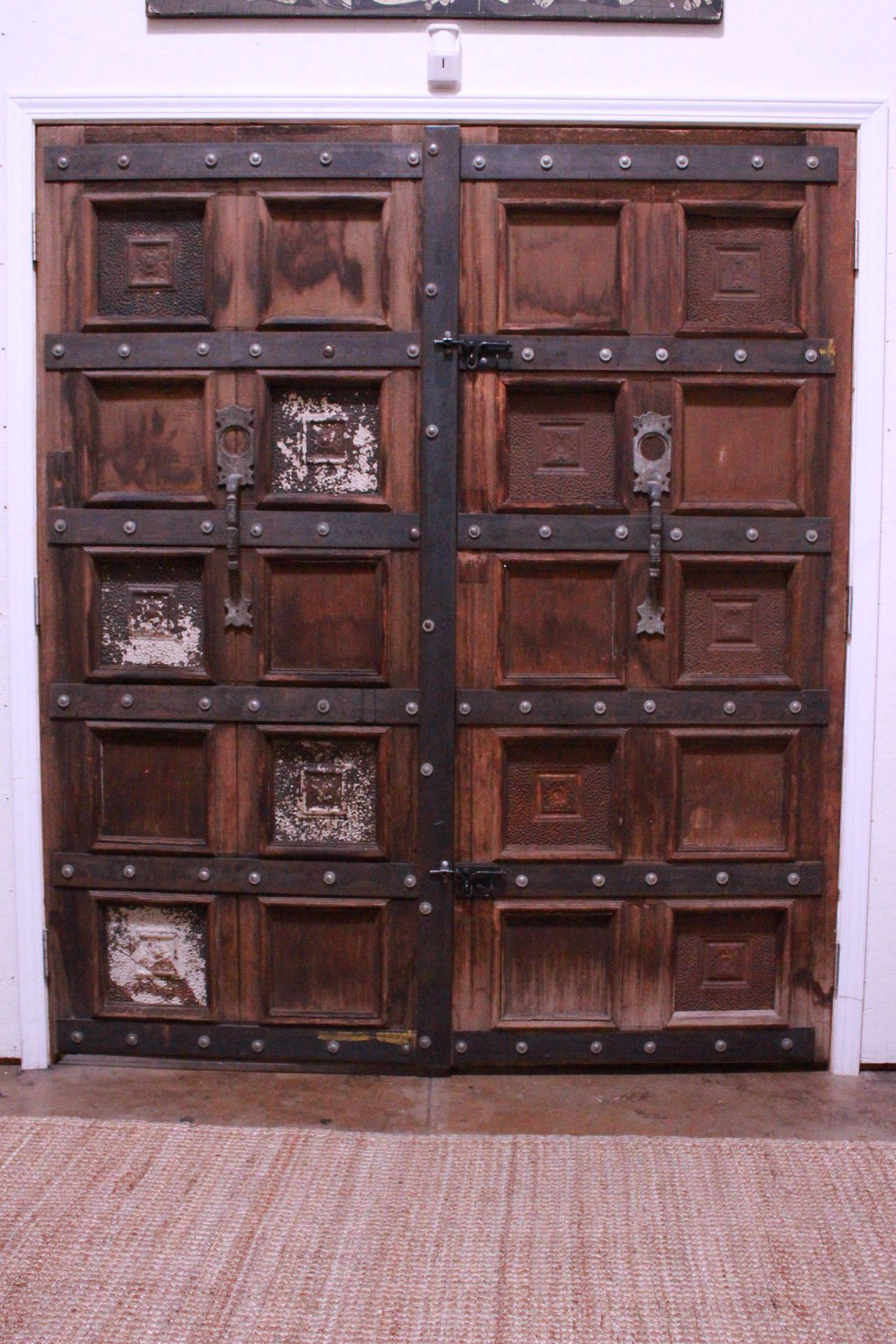 Double wooden door. Doors been reinforced with the metal bars at 1992 by Mateo Ferrer local artist  as shown on the photos. Came from Gypsy Antiques in Hollywood.