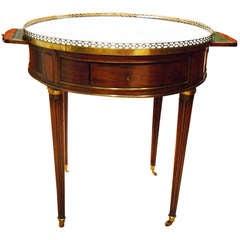 A Louis XVI Mahogany & Marble Bouillotte Table