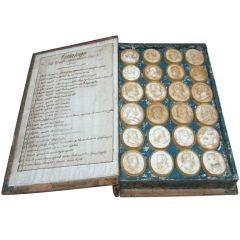 An Italian Grand Tour Cased Volume Of Plaster Intaglios