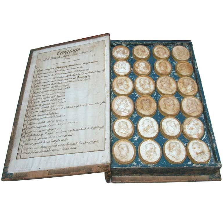 An Italian Grand Tour Cased Volume Of Plaster Intaglios At