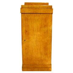 A Biedermeir Birch Pedestal Cabinet