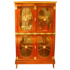 An Austrian Neoclassic Parcel-gilt Mahogany Bookcase