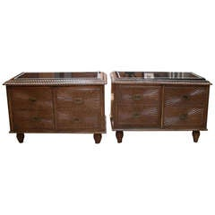 A pair of Colonial carved hardwood cabinets with marble tops