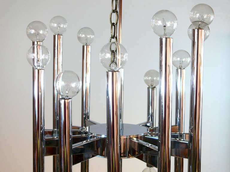 Twenty-two-light chrome chandelier by Gaetano Scolari. Lights on the top and the bottom. Classic chrome design.