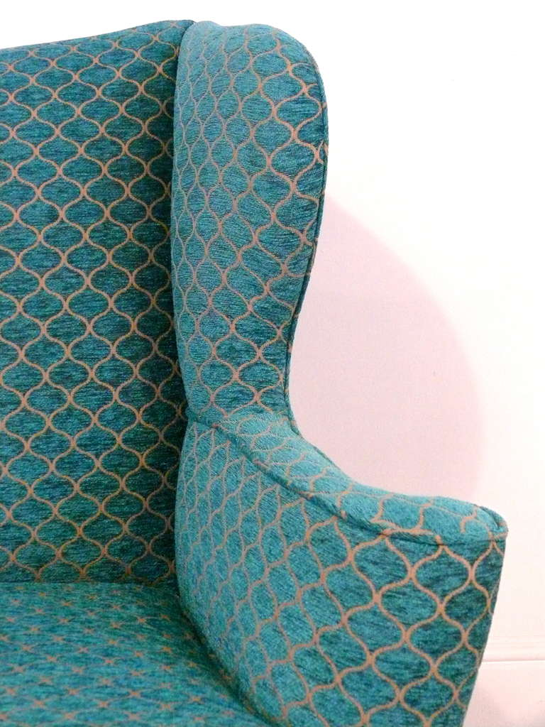 Mid-20th Century Pair of Curvaceous Wingback Chairs For Sale