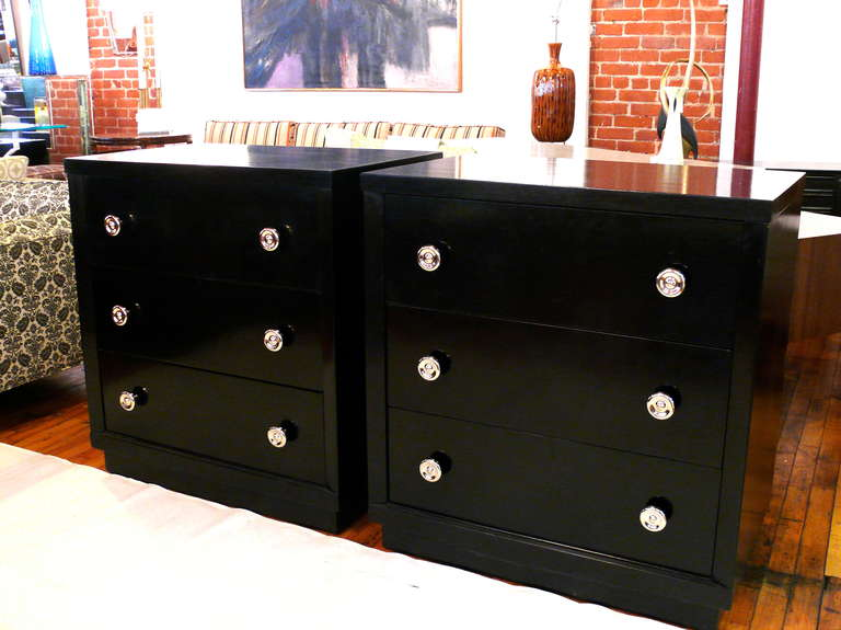 Pair of ebonized Mid-Century chests with three drawers and nickel-plated round pulls. Three drawers each.