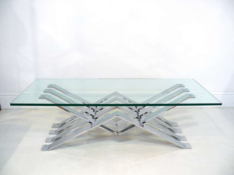 Spectacular glass coffee table with a layered zig-zag chrome base. The chrome is in excellent vintage condition. Shown here with a 54