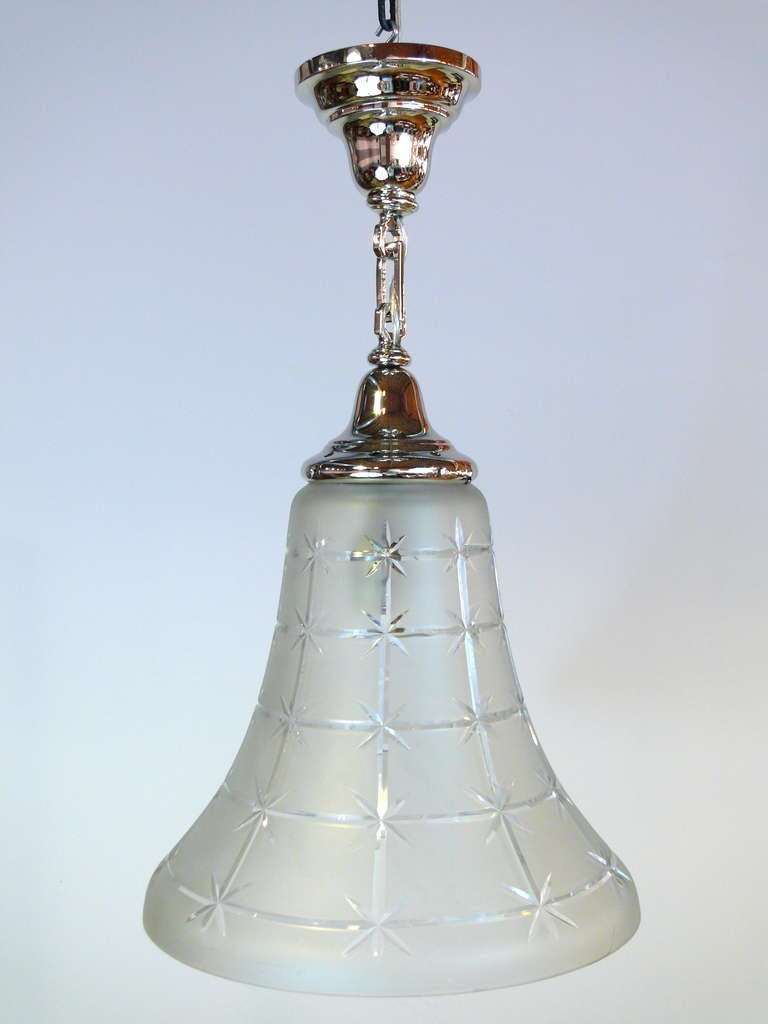 Bell shaped chandelier with inside glass, circa 1930. Newly nickel-plated and rewired.