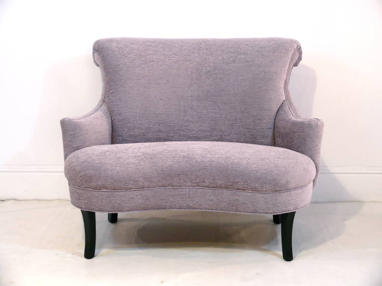 1940s petite settee with scroll arms, fixed curved seat cushion and gloss ebonized legs. Reupholstered in a beautiful lavender chevron chenille.