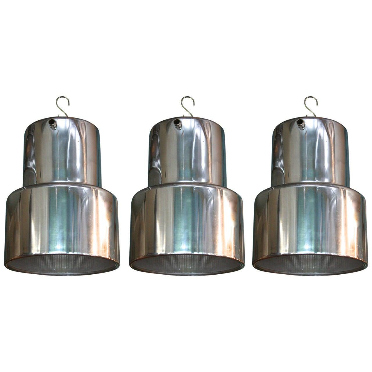 Set of Three Polished Aluminum and Holophane Glass Pendant Lights 1