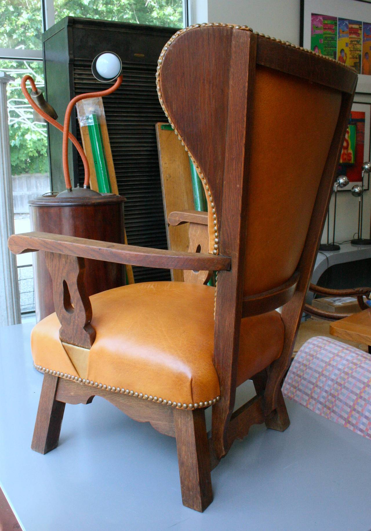 Oak and caramel leather wing chair For Sale at 1stdibs
