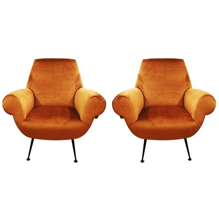 Pair of sleek Armchairs, Italy 1950s