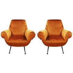 Pair of sleek Armchairs, Italy 1950s