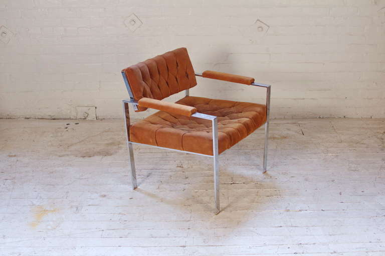 Great-looking armchair by Harvey Probber with chrome-plated steel frame and original burnt-orange suede upholstery. Very well-made, solid chair.