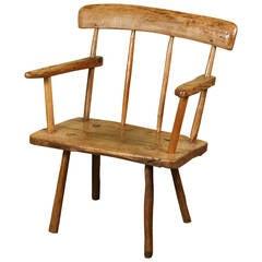 """An Irish Pine and Oak """"Hearthside"""" Chair, circa 1840"""