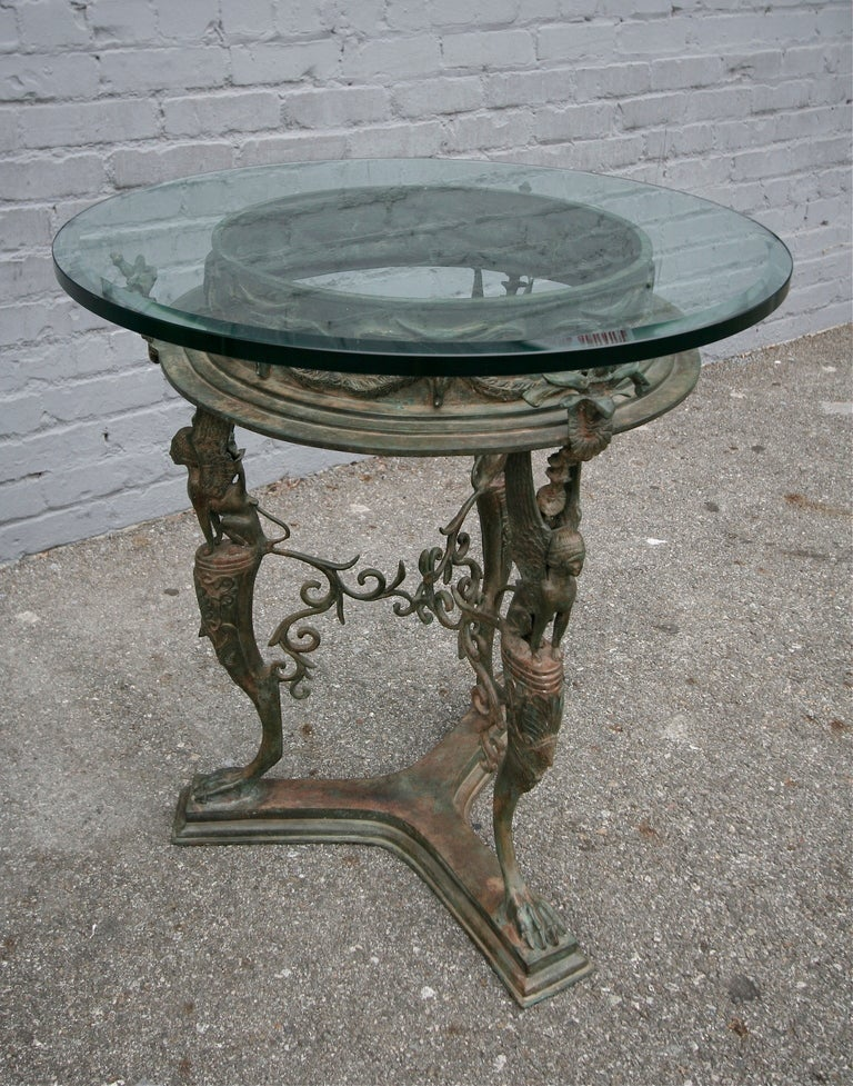 Late 19th century French imperial bronze side or centre table with glass top.