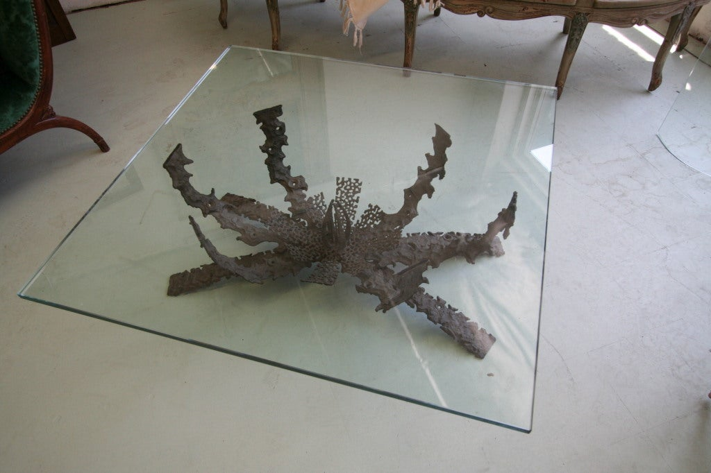 1960s brutalist bronze coffee table with glass top, by Daniel Gluck.