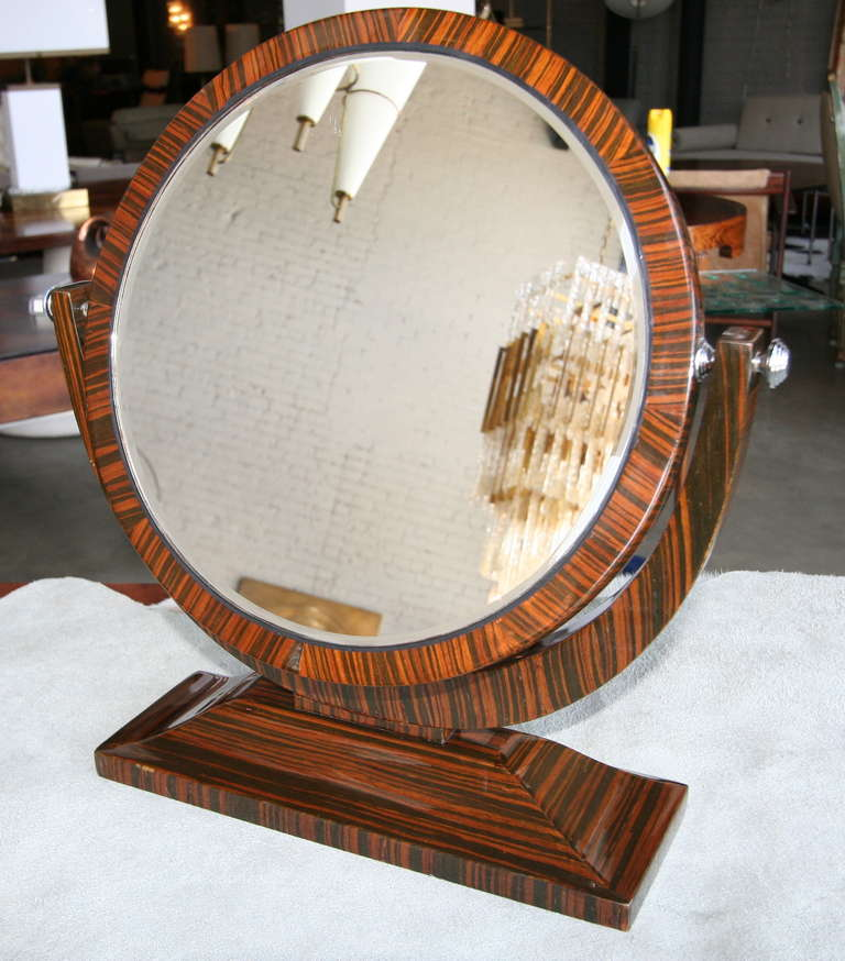 Macassar ebony vanity mirror from the 1950s with tilting mirror and chrome accents.