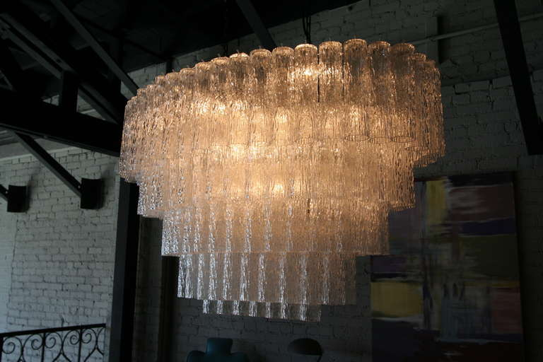 Large 1970s Venini Murano clear glass chandelier with five tiers of textured glass.
