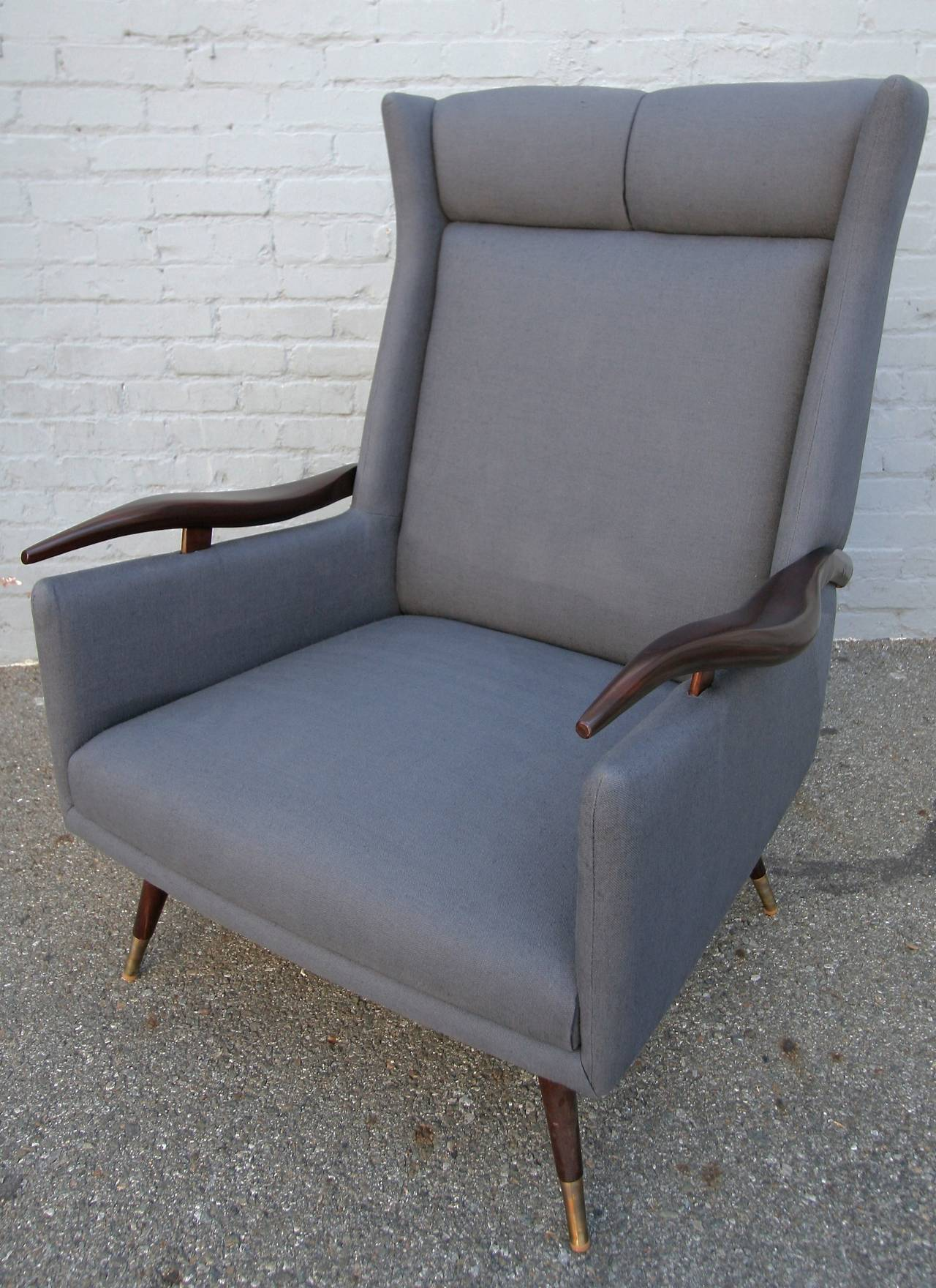 Pair of very comfortable 1950s Brazilian lounge / armchairs chairs with wooden arms and brass feet.