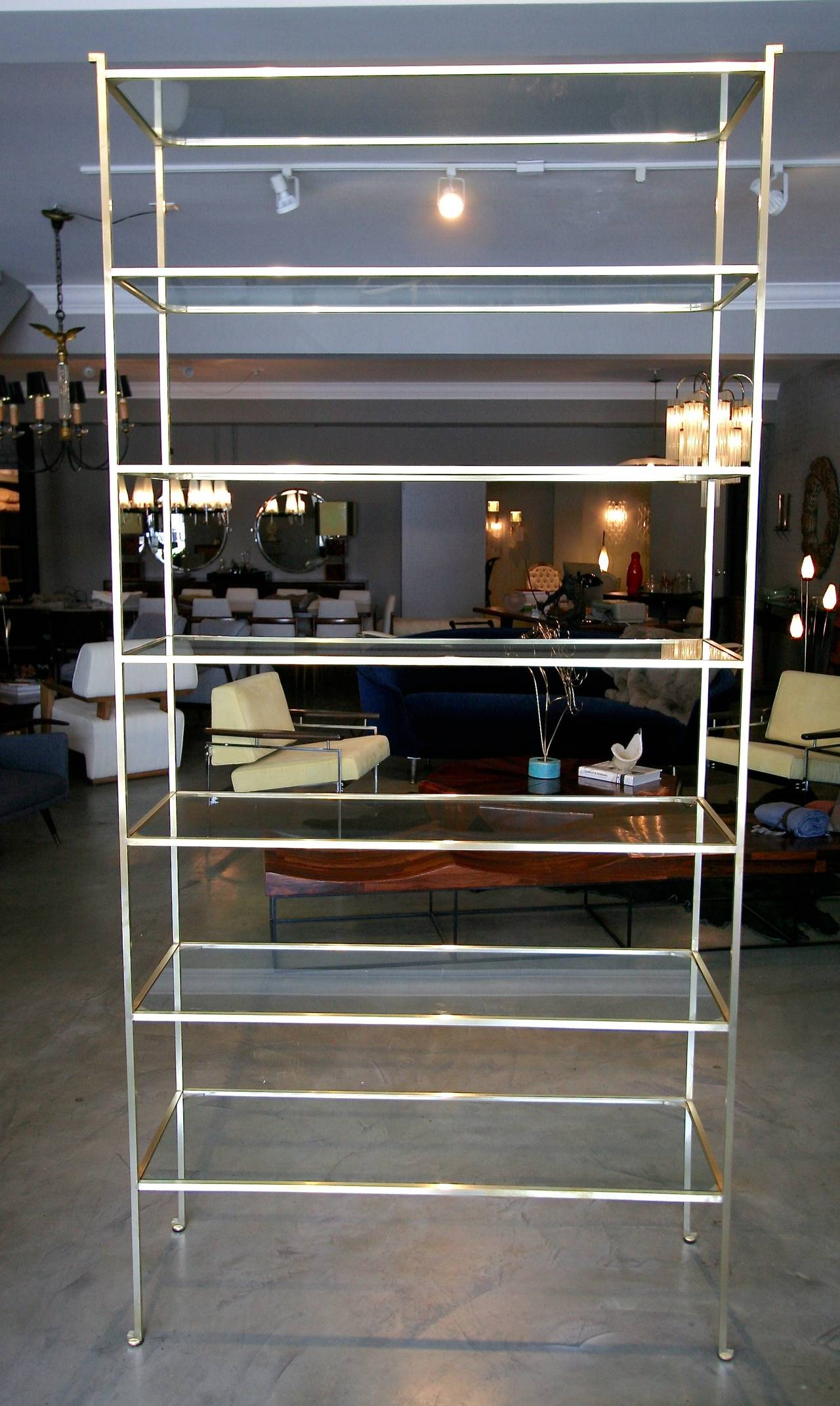 Mid-Century Modern Pair of Tall Custom Brass Étagères with Glass Shelves For Sale