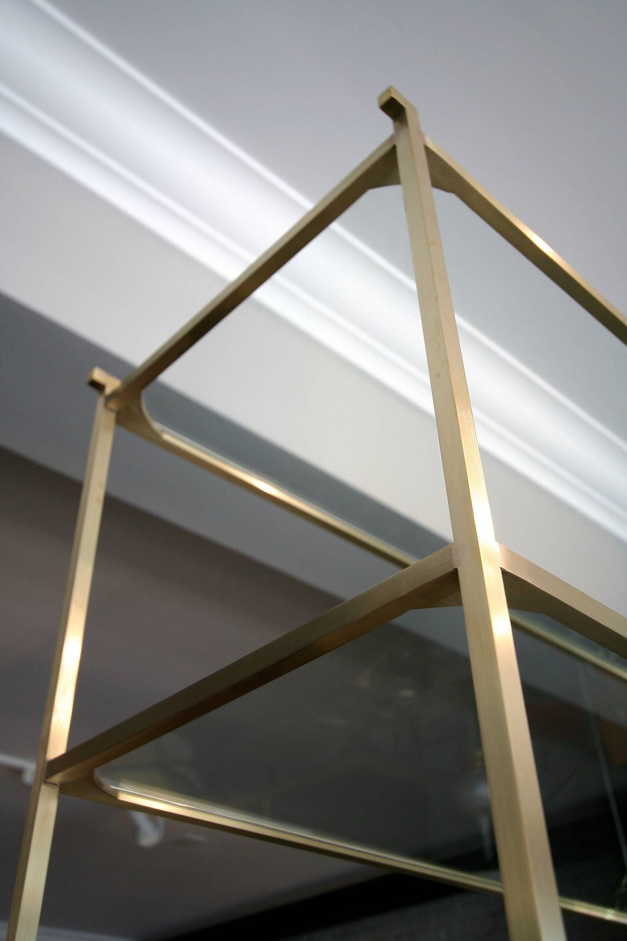 Contemporary Pair of Tall Custom Brass Étagères with Glass Shelves For Sale