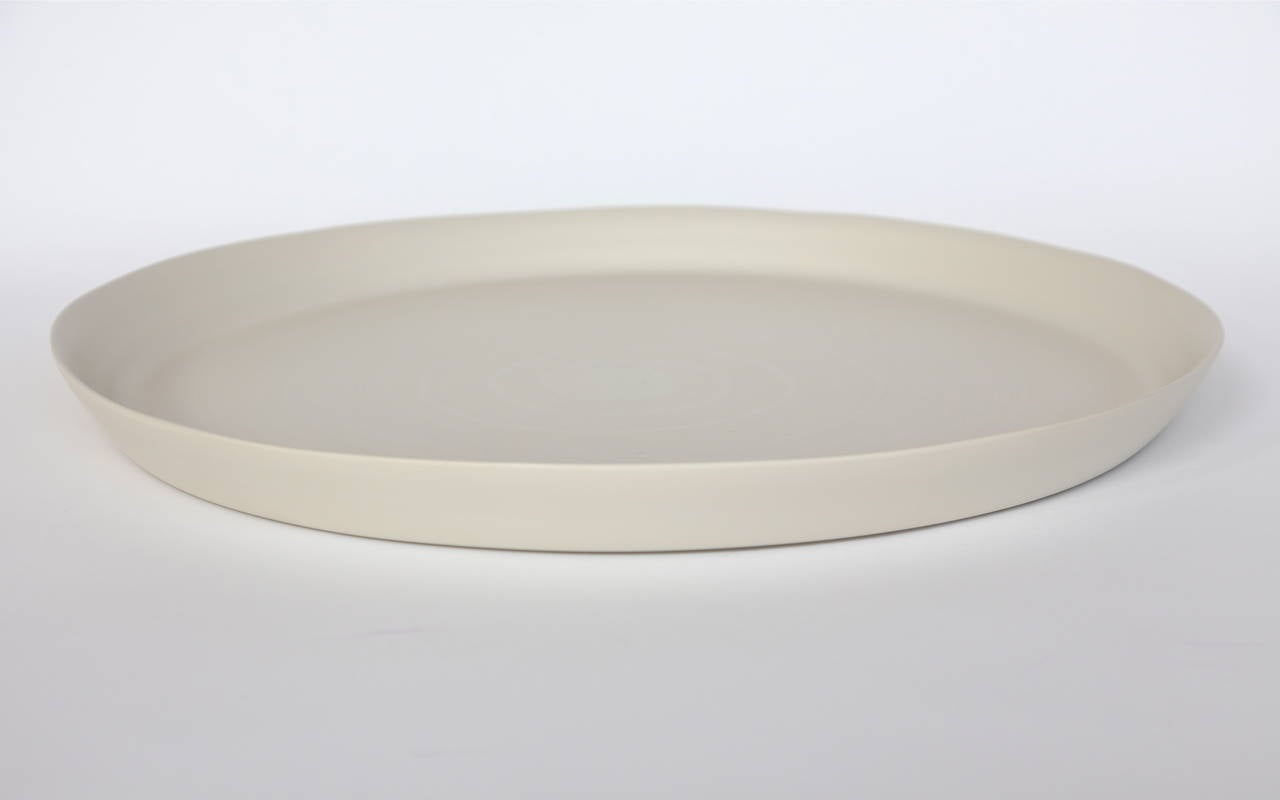Italian handmade ceramic bowls, plates and tableware in linen, bronze, light brown and white by Rina Menardi.