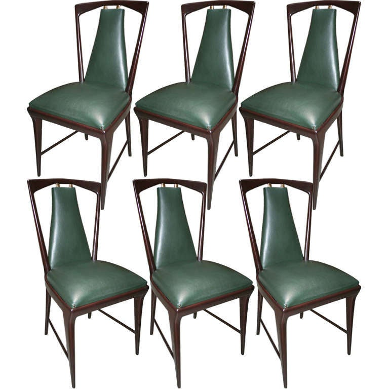 Six dining room chairs with a matching table by borsani at for Matching dining room furniture
