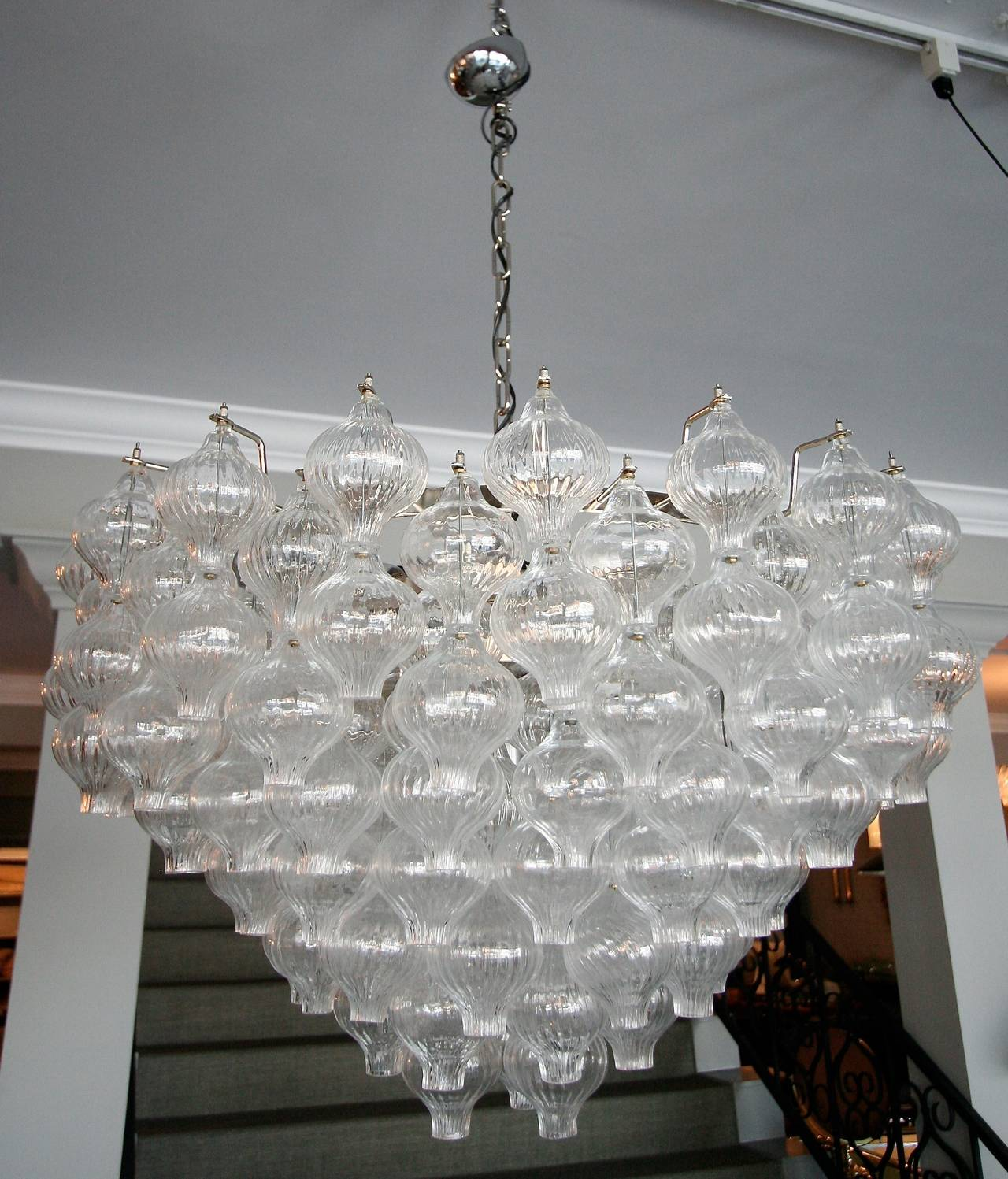 Murano glass chandelier with 95 double glass tulip shaped balls to make hourglass shapes.