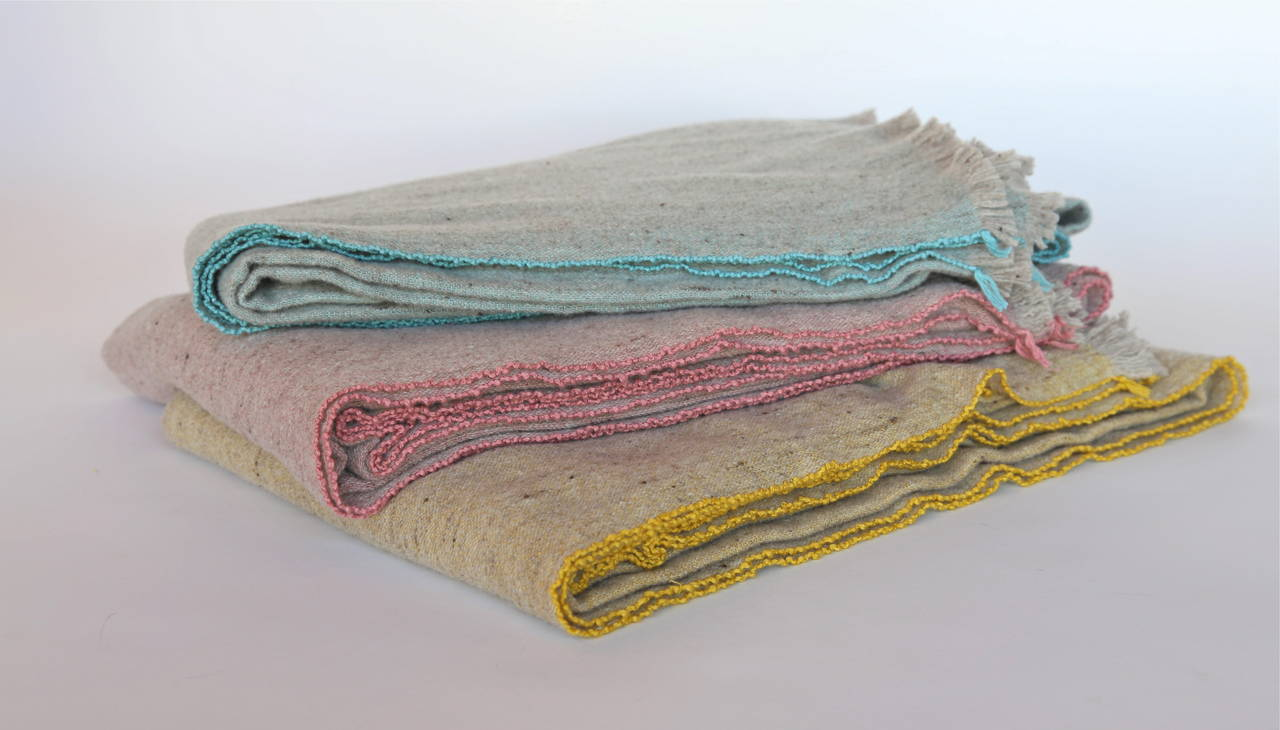 Merino wool and bamboo blankets in turquoise, pink and mustard.