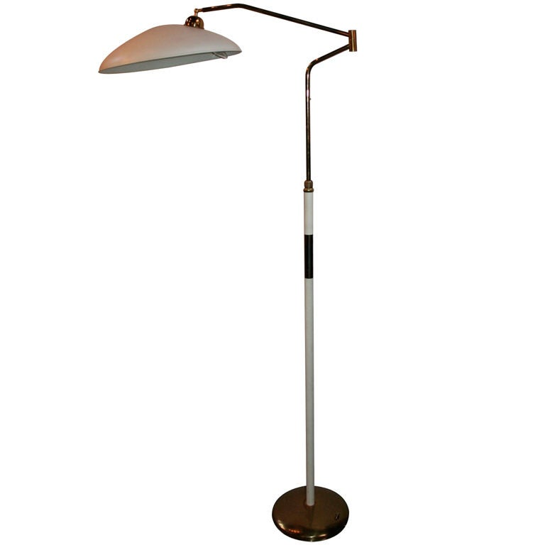 Elegant 1960s Stilnovo metal and brass floor lamp with three lights and a movable shade. Height is adjustable.