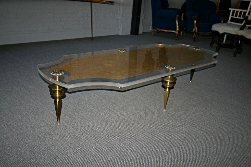 60 39 S Lucite Coffee Table With Sculptural Brass Legs At 1stdibs