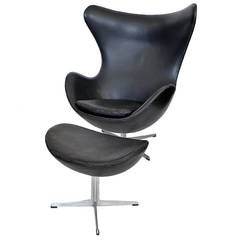 Early Egg Chair and Ottoman by Arne Jacobsen with Original Black Leather