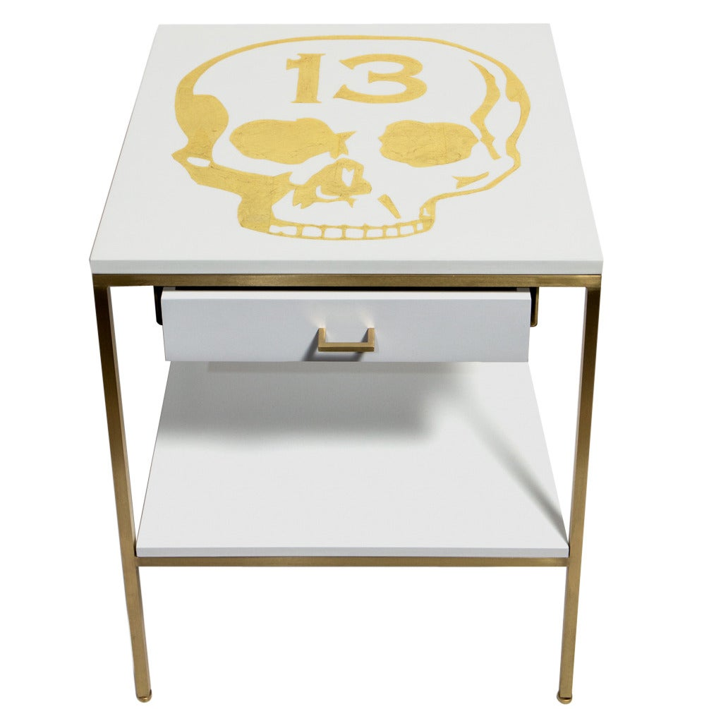 white lacquered bedside tables with gold leafed icons by dylan egon 1