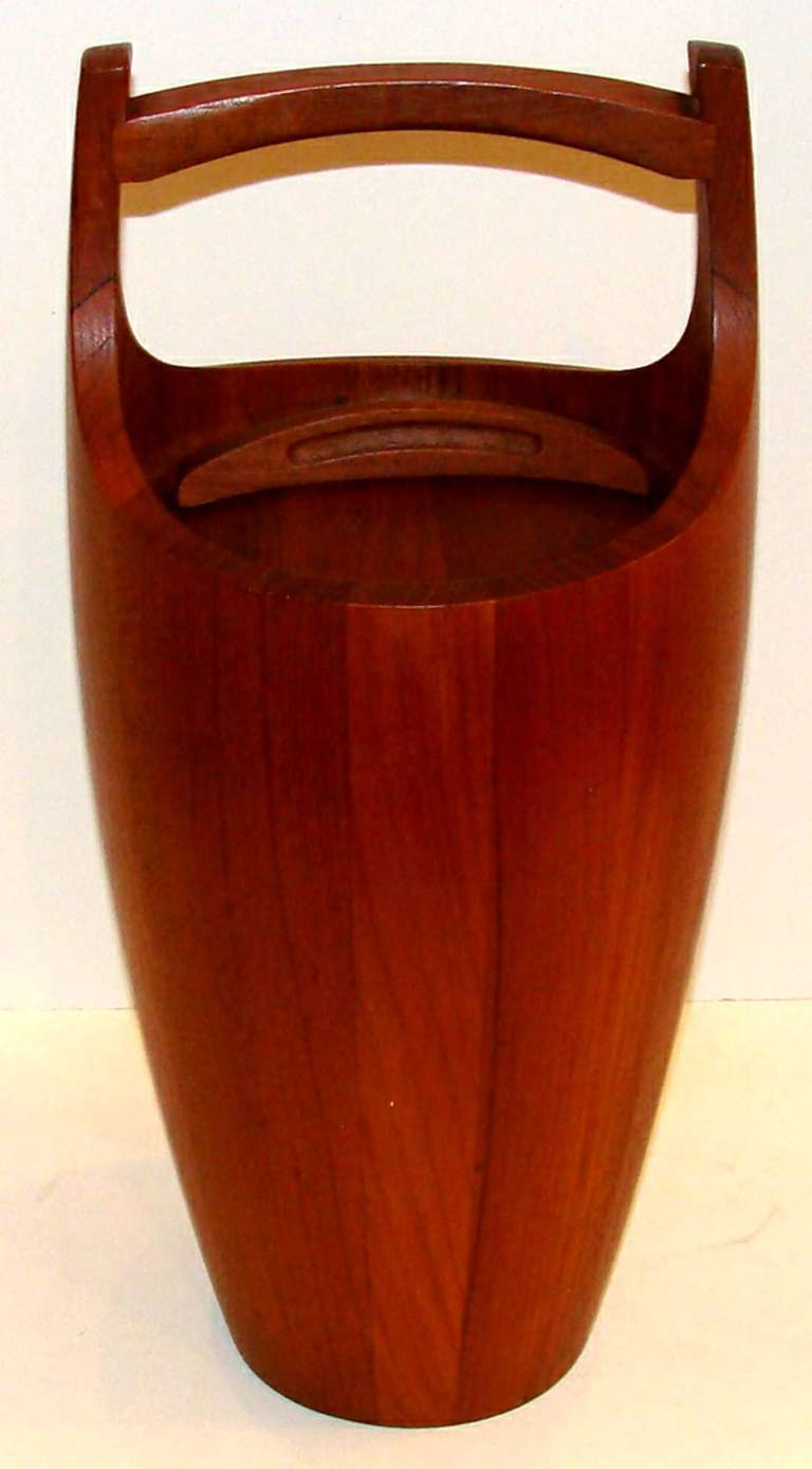 """This is the large size ice bucket designed by Jens Quistgaard for Dansk Designs.  Marked """"Made in Denmark"""".  Gorgeous teak in outstanding original condition and featuring rare white lining."""