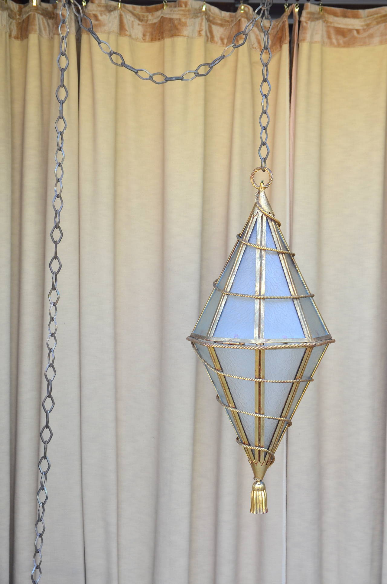 Spectacular Italian gilt metal geometric hanging lantern. Comes with extra-long (12 feet) custom chain.