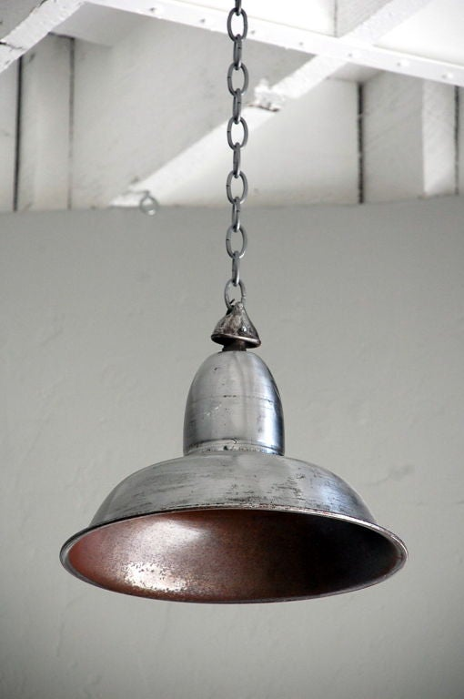 Polished steel French Industrial hanging light. Adjustable chain.