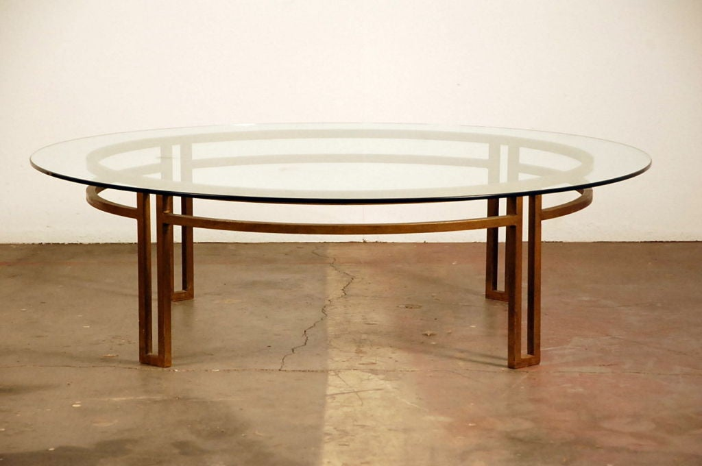 this large gilt wrought iron and glass round coffee table is no longer
