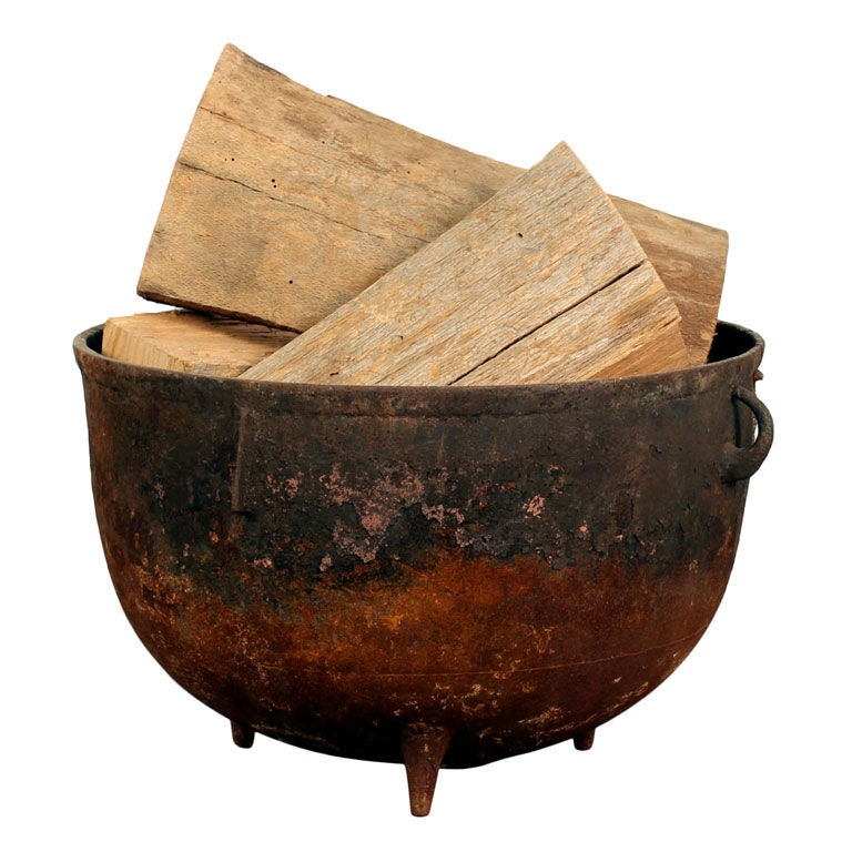 Industrial cauldron chimney wood holder