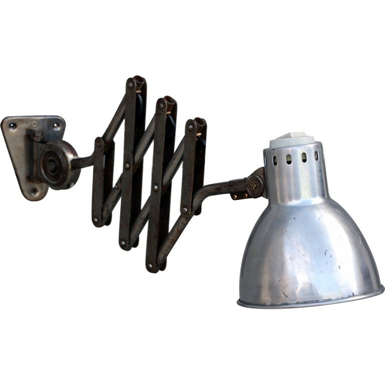 Polished steel French industrial extentable sconce at 1stdibs