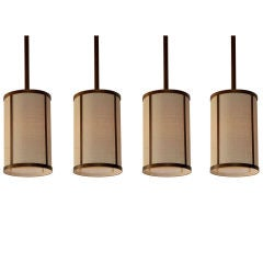 Set of Four 'Cylindre' Patinated Brass & Raffia Pendant Lights by Design Frères