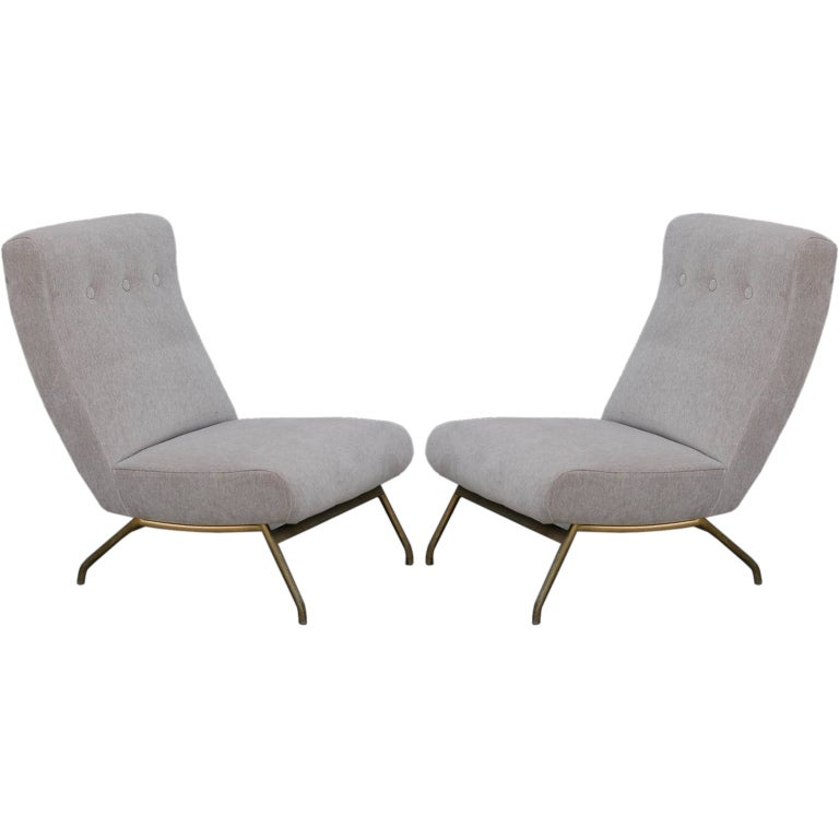 Pair of fortable French lounge chairs by Joseph André Motte at 1stdibs