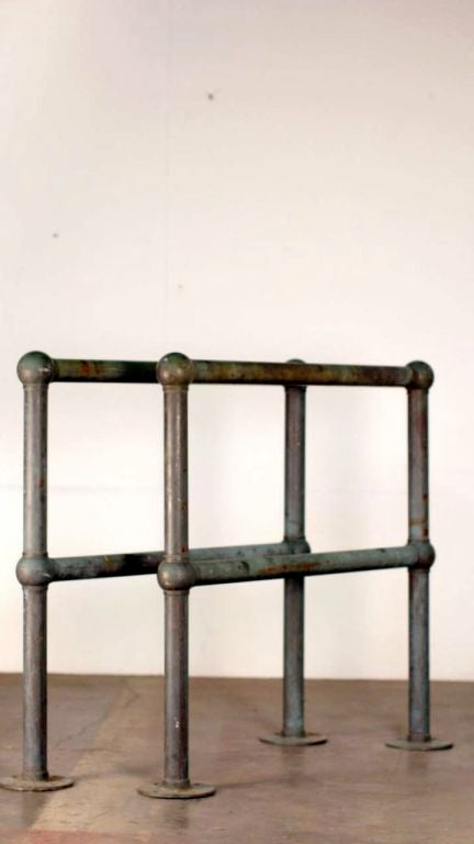 Pair of bronze architectural railings. 2 1/2 inch diameter sections. The floor plate is 8 in. in diameter.