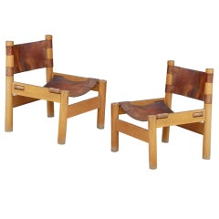 Pair of French oak and leather low chairs