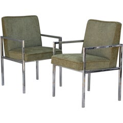 Pair of chic chromed steel upholstered armchairs