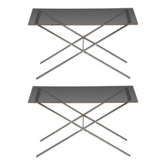 Pair of minimalistic stainless steel and glass side tables