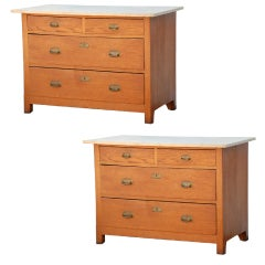 Pair of Arts & Crafts oak and travertine chest of drawers