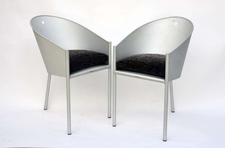 Pair of sculptural chairs by Philippe Starck. New wool-upholstered seat cushions.